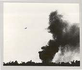 view Airplane in sky, dark smoke on the ground digital asset: Photograph, Airplane in sky, dark smoke on the ground