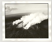 view A helicopter is dwarfed by the active Pu'u' 'O'o vent of the Kilauea volcano on the last day of the year digital asset: Photograph, silver gelatin, A helicopter is dwarfed by the active Pu'u' 'O'o vent of the Kilauea volcano on the last day of the year