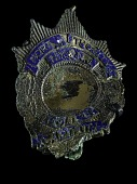 view 9/11 Port Authority Police Captain's Badge digital asset: Port Authority Badge worn by Captain Kathy N. Mazza during rescue operations at the World Trade Center on September 11, 2001