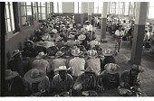 view Braceros at Meal Time digital asset: Braceros have lunch in dining hall at the Monterrey Processing Center, Mexico.