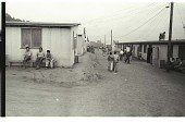 view Braceros at Camp digital asset: Braceros stay outside their living quarters in the Gondo Labor Camp, Watsonville.