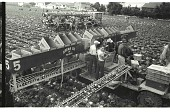 view Braceros in Lettuce Field digital asset: Braceros load lettuce boxes on a machine in a field in the Salinas Valley, California.