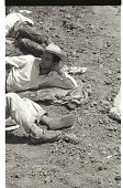 view Braceros in Field digital asset: Braceros lie down and have a rest on the edge of a field in California.