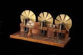 view Farmer Wind-Electric Generator Model digital asset: Model of Storage Battery Plant with three wind wheels and magneto-electric generators