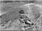 view Portrait of Young Algonquin Boy on Cart digital asset: Portrait of Young Algonquin Boy on Cart