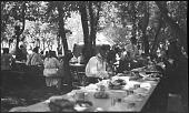 view Eating dinner camp meeting Winnebago digital asset: Eating dinner camp meeting Winnebago
