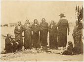 view Sicangu Lakota (Brulé Sioux) and Oohenonpa Lakota (Two Kettle Sioux) group digital asset: [P15377] Sicangu Lakota (Brulé Sioux) and Oohenonpa Lakota (Two Kettle Sioux) men and women and an interpreter gathered at Fort Laramie for the 1868 treaty signing. From left to right: Leon Palladay (interpreter), Fast Bear, Spotted Tail, White Eyes, Swift Bear, Whirlwind Soldier, Long Mandan, unidentified child, The Mule's wife, Big Partisan's daughter