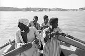 view Man and boys rowing felucca, near Aswan, Egypt digital asset: Man and boys rowing felucca, near Aswan, Egypt
