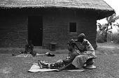view Hairdressing among Mangbetu people, Medje village, Congo (Democratic Republic) digital asset: Hairdressing among Mangbetu people, Medje village, Congo (Democratic Republic)
