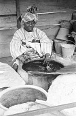 view Yoruba woman dyeing fabrics with indigo, Ife, Nigeria digital asset: Yoruba woman dyeing fabrics with indigo, Ife, Nigeria