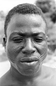 view Edo-speaking man with facial scarifications, Benin City, Nigeria digital asset: Edo-speaking man with facial scarifications, Benin City, Nigeria