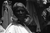 """view Woman with four-lobed gold earrings, known locally as """"kwottenai,"""" Mopti, Mali digital asset: Woman with four-lobed gold earrings, known locally as """"kwottenai,"""" Mopti, Mali"""