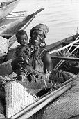 view Woman and child in boat, Mopti, Mali digital asset: Woman and child in boat, Mopti, Mali