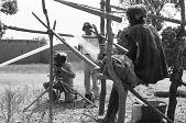 view Eliot Elisofon and cameraman George Bracher filming Bamana weaver. Senou village, Mali digital asset: Eliot Elisofon and cameraman George Bracher filming Bamana weaver. Senou village, Mali