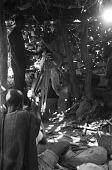 view Cameraman Georges Bracher filming Dolo, the blacksmith. Ogol du Haut village, Mali digital asset: Cameraman Georges Bracher filming Dolo, the blacksmith. Ogol du Haut village, Mali