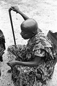 view Asante man watching wari players, Besease, Ghana digital asset: Asante man watching wari players, Besease, Ghana
