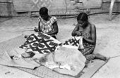 view Kuba women decorating woven cloth, Mushenge, Congo (Democratic Republic) digital asset: Kuba women decorating woven cloth, Mushenge, Congo (Democratic Republic)
