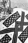 view Kuba woman decorating woven cloth, Mushenge, Congo (Democratic Republic) digital asset: Kuba woman decorating woven cloth, Mushenge, Congo (Democratic Republic)