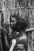 view Women by fence, near Mushenge, Congo (Democratic Republic) digital asset: Women by fence, near Mushenge, Congo (Democratic Republic)