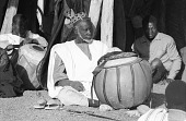 view Mossi musician with drum called bendre, performed only at the court of Moro Naba Kougri, Ouagadougou, Burkina Faso digital asset: Mossi musician with drum called bendre, performed only at the court of Moro Naba Kougri, Ouagadougou, Burkina Faso