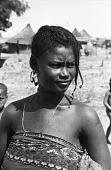 view Mossi woman with elaborate hairstyle, near Ouagadougou, Burkina Faso digital asset: Mossi woman with elaborate hairstyle, near Ouagadougou, Burkina Faso