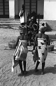 view Two girls dancing for John Adetoyese Laoye I, Timi of Ede. Ede, Nigeria digital asset: Two girls dancing for John Adetoyese Laoye I, Timi of Ede. Ede, Nigeria