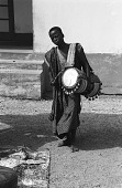view Drummer playing for John Adetoyese Laoye I, Timi of Ede. Ede, Nigeria digital asset: Drummer playing for John Adetoyese Laoye I, Timi of Ede. Ede, Nigeria
