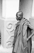 view Man in shrine house courtyard, Besease, Ghana digital asset: Man in shrine house courtyard, Besease, Ghana