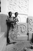 view Woman and child in shrine house courtyard, Besease, Ghana digital asset: Woman and child in shrine house courtyard, Besease, Ghana