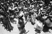 view Senufo women dancing around drums, near Korhogo, Ivory Coast digital asset: Senufo women dancing around drums, near Korhogo, Ivory Coast