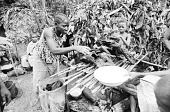 view Mbuti people bartering forest products, Epulu, Ituri Forest, Congo (Democratic Republic) digital asset: Mbuti people bartering forest products, Epulu, Ituri Forest, Congo (Democratic Republic)