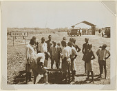 view Group of boys waiting by town sign, Nimule, Sudan digital asset: Group of boys waiting by town sign, Nimule, Sudan