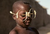 view Dogon boy with false wooden glasses, Dogon region, Mali digital asset: Children