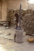 view child grinding millet crop Dogon region, Mali digital asset: child grinding millet crop Dogon region, Mali