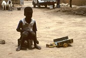 view Child with toy cart, Dogon region, Mali digital asset: Child with toy cart, Dogon region, Mali