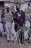 view Woman weaving a basket digital asset: Woman weaving a basket
