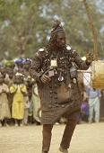 view A Bamana hunter-griot (bard) performing a dance, Narena village, Mali digital asset: A Bamana hunter-griot (bard) performing a dance, Narena village, Mali