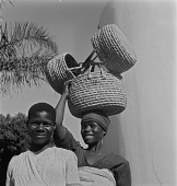 view Two Women with Baskets, Natal, South Africa digital asset: Two Women with Baskets