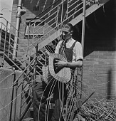 view Young Blind Man Weaving A Basket digital asset: Young Blind Man Weaving A Basket