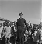 view Father Huddleston with Children, Sophiatown, Johannesburg digital asset: Father Huddleston With Children
