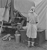 view Woman washing dishes in Afrikaner camp, Bronkhorstspruit (South Africa) digital asset: Woman washing dishes in Afrikaner camp, Bronkhorstspruit (South Africa)