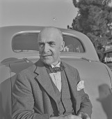 view Man leaning against car, South Africa digital asset: Man leaning against car, South Africa