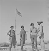 view San men and officer, Kalahari Desert, Botswana digital asset: San men and officer, Kalahari Desert, Botswana