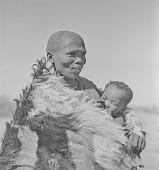 view San woman with baby, Kalahari Desert, Botswana digital asset: San woman with baby, Kalahari Desert, Botswana
