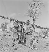 view San man selling meat, Kalahari Desert, Botswana digital asset: San man selling meat, Kalahari Desert, Botswana
