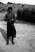 view Pende woman with guhota sanga hairstyle, Village de Katundu II digital asset: Pende woman with guhota sanga hairstyle, Village de Katundu II
