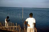 view Boys fishing with hooks on Ikoyi Island, Lagos, Nigeria digital asset: Boys fishing with hooks on Ikoyi Island, Lagos, Nigeria