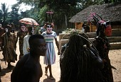 view Players wearing mma ji and ibibio masks, with agbogho mma player and praise singer (in the foreground) in the njenji parade at Ezi Nwachi compound, Ndibe village, Afikpo Village-Group, Nigeria digital asset: Players wearing mma ji and ibibio masks, with agbogho mma player and praise singer (in the foreground) in the njenji parade at Ezi Nwachi compound, Ndibe village, Afikpo Village-Group, Nigeria