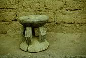 view Carved Bent Legged Stool, Obado Omaze's Compound, Afokpella, Okpella, Etsako, Edo State, Nigeria digital asset: Carved Bent Legged Stood, Obado Omaze's Compound, Afokpella, Okpella, Etsako, Edo State, Nigeria