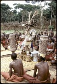 view Kuba Nyim (ruler) Kot a-Mbweeky III, in state dress with royal drum and royal basket, Mushenge, Congo (Democratic Republic) digital asset: Kuba Nyim (ruler) Kot a-Mbweeky III, in state dress with royal drum and royal basket, Mushenge, Congo (Democratic Republic)